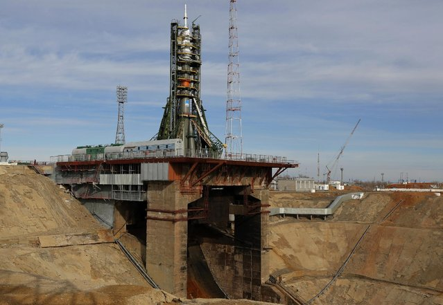 Russia's Soyuz-FG booster rocket with the space capsule Soyuz TMA-16M that will carry a new crew to the International Space Station (ISS) is installed at the launch pad in Russian leased Baikonur cosmodrome, Kazakhstan, Friday, March 27, 2015. (Photo by Dmitry Lovetsky/AP Photo)