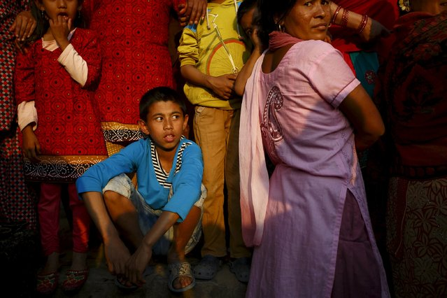 Nepalese people gather to observe the Bisket festival at Bhaktapur April 10, 2015. (Photo by Navesh Chitrakar/Reuters)