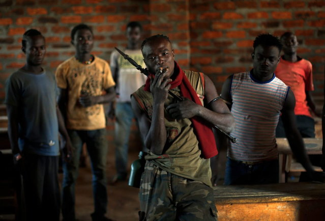 Former FARCA (Central African Republic Forces) soldiers linked to Anti-Balaka Christian militiamen who have set up camp in a school in the Boeing neighborhood of the Central African Republic's capital Bangui pose Sunday December 15, 2013. (Photo by Jerome Delay/AP Photo)