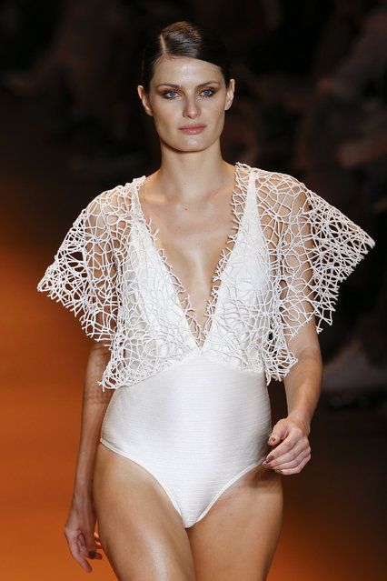 Brazilian model Isabeli Fontana wears a creation from Agua de Coco Summer collection during the Sao Paulo Fashion Week in Sao Paulo, Brazil, Tuesday, April 14, 2015. (Photo by Andre Penner/AP Photo)