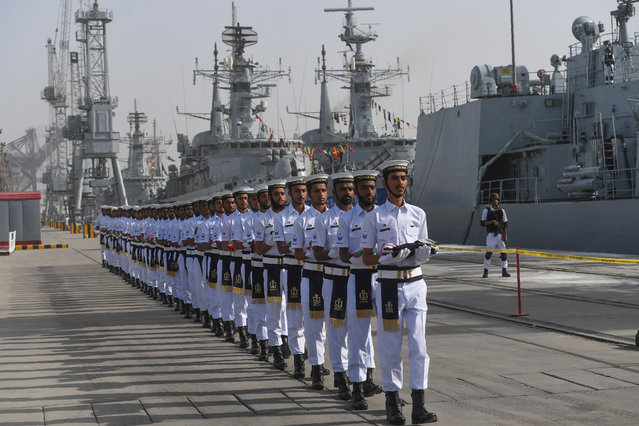 "Pakistani Naval personnel march as they carry the flags of the countries participating in the navy's Multinational Exercise ""AMAN-19"" in Karachi on February 8, 2019. Exercise Aman is scheduled from February 8-12, in which over 45 countries are participating with ships and observers. (Photo by Asif Hassan/AFP Photo)"