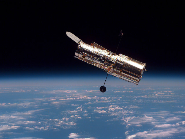 The Hubble Space Telescope is shown following its release from the space shuttle Discovery Wednesday, February 19, 1997. The Hubble Space Telescope, one of NASA'S crowning glories, marks its 25th anniversary on Friday, April 24, 2015. With more than 1 million observations, including those of the farthest and oldest galaxies ever beholden by humanity, no man-made satellite has touched as many minds or hearts as Hubble. (Photo by AP Photo/NASA)