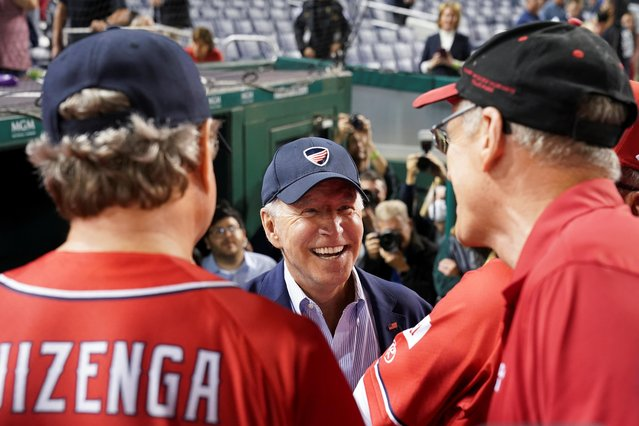U.S. President Joe Biden speaks with members of the Republicans team as he attends the annual Congressional Baseball Game at Nationals Park in Washington, U.S., September 29, 2021. (Photo by Kevin Lamarque/Reuters)