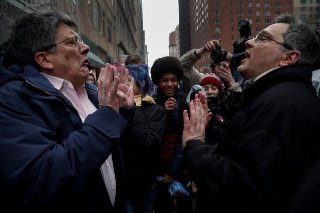 A supporter of U.S. President Donald Trump (R) argues with a protester as New York City high school students look on during a protest against Trump's immigration policies in lower Manhattan, New York, U.S., February 7, 2017. (Photo by Mike Segar/Reuters)