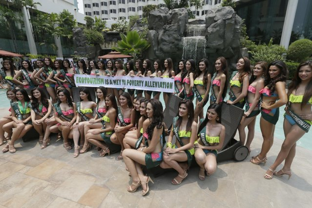 Candidates for this year's Miss Philippines- Earth beauty pageant pose by the poolside of a hotel during a media presentation Thursday, May 7, 2015 in Manila, Philippines. At total 41 candidates will vie for the title and a chance to represent the Philippines in the Miss Earth 2015, a beauty pageant with a unique theme to save Mother Earth. (Photo by Bullit Marquez/AP Photo)