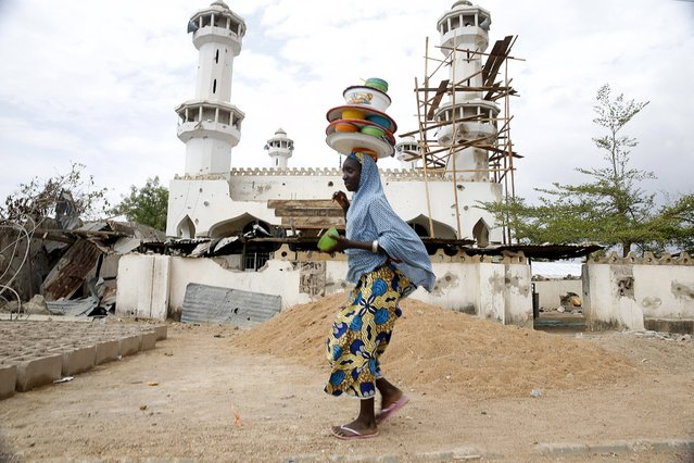 A girl walks past a destroyed mosque in the town of Mararaba, after the Nigerian military recaptured it from Boko Haram, in Adamawa state May 10, 2015. (Photo by Akintunde Akinleye/Reuters)