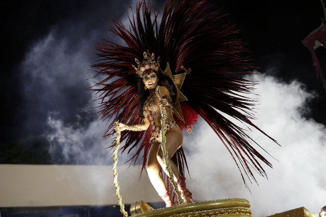 A performer from the Academicos do Grande Rio samba school parades on a float during carnival celebrations at the Sambadrome in Rio de Janeiro, Brazil, Sunday, March 2, 2014. (Photo by Silvia Izquierdo/AP Photo)