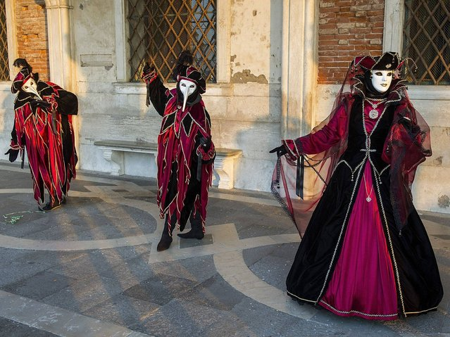 The Carnival of Venice includes a program of gala dinners, parades, dances, masked balls and music events. (Photo by Marco Secchi/Getty Images)