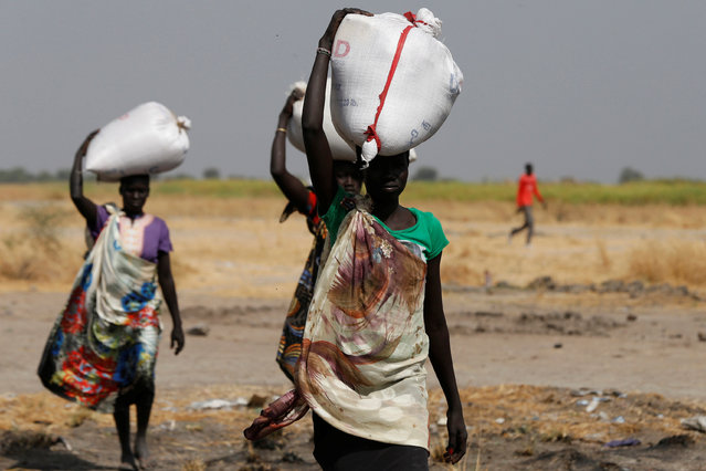 Women carry sacks of food in Nimini village, Unity State, northern South Sudan, February 8, 2017. (Photo by Siegfried Modola/Reuters)