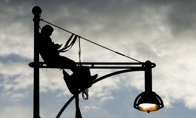 An Extinction Rebellion environmental activist seen having climbed up a lamppost on Oxford Street on April 24, 2019 in London, England. Police negotiators on the scene estimate he spent the night of Day 10 of Extinction Rebellions current London campaign amid rumour of a large action planed for the financial district by the activists in ongoing protests. The climate activist group have announced that they will be voluntarily ending their blockades around London at 5pm on April 25 after 12 days of protests. (Photo by Ollie Millington/Getty Images)