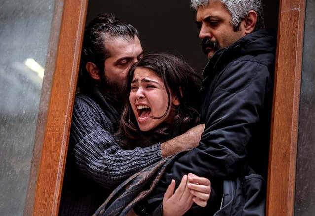 Family members cry as people carry the coffin of Berkin Elvan, a Turkish teenager who was in a coma since being hit in the head by a tear gas canister fired by police during the summer's anti-government protests, in Istanbul, on March 11, 2014. The 15-year old's death in an Istanbul hospital, nine months after he fell into a coma, looks likely to spark new protests in Turkey. Elvan was caught up in the protests on his way to a shop to buy bread. (Photo by Emrah Gurel/Associated Press)
