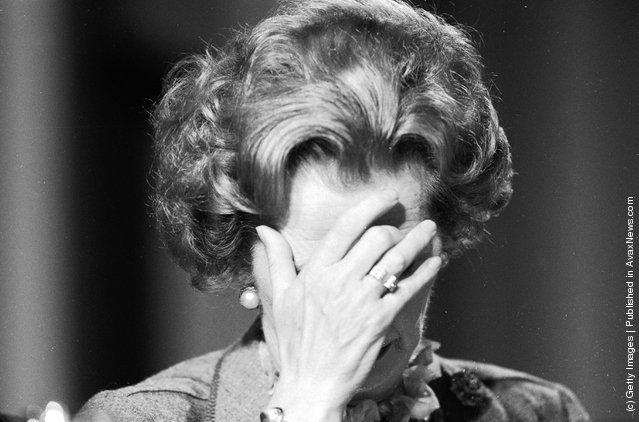 British prime minister Margaret Thatcher covering her face with her hand at the 1985 Conservative Party Conference