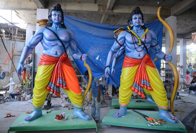 An Indian artist puts the final touches to statues of the Hindu God Lord Ram ahead of the Sri Rama Navami Festival at a workshop in Hyderabad on April 13, 2016. Sri Rama Navami will be held on April 15 and celebrates both the birth of Rama and his wedding to Sita. (Photo by Noah Seelam/AFP Photo)