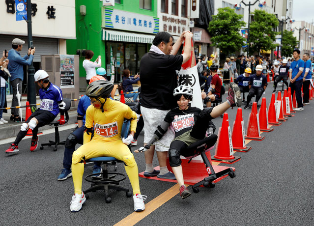 A racer crushes during ISU-1 Hanyu Grand Prix, while taking part in the office chair race ISU-1 Grand Prix series, in Hanyu, north of Tokyo, Japan, June 9, 2019. (Photo by Issei Kato/Reuters)