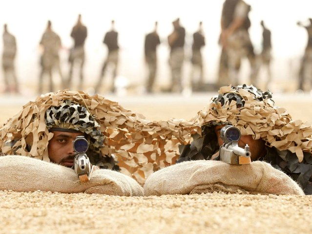 Members of Saudi special forces aim their guns during a training session in Darma, west of Riyadh, Saudi Arabia March 26, 2014. (Photo by Faisal Al Nasser/Reuters)