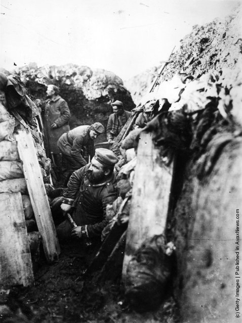 1914: German soldiers in the trenches during WWI