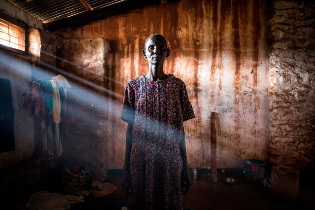 Elizabeth, a South Sudanese Refugee, poses inside a refugee transition camp in Aru for South Sudanese who have just arrived in the Democratic Republic of the Congo, on May 12, 2019. A recent increase in fighting between South Sudanese government forces and rebels groups along the South Sudan and DRC border has cause thousands to seek refuge in DRC since the beginning of the year. (Photo by John Wessels/AFP Photo)