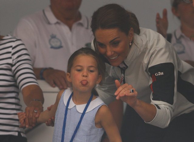 Britain's Princess Charlotte sticks her tongue out next to her mother, Catherine Duchess of Cambridge, before a presentation ceremony following the King's Cup Regatta in Isle of Wight, Britain on August 8, 2019. (Photo by Peter Nicholls/Reuters)