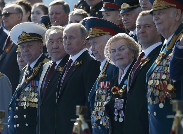 Russian President Vladimir Putin (4th L), Prime Minister Dmitry Medvedev (2nd R), Kazakh President Nursultan Nazarbayev (3rd L) and World War Two veterans attend the Victory Day parade, marking the 71st anniversary of the victory over Nazi Germany in World War Two, at Red Square in Moscow, Russia, May 9, 2016. (Photo by Grigory Dukor/Reuters)
