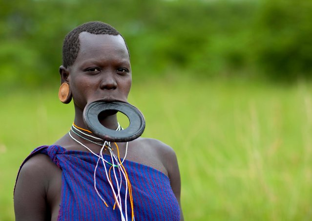 The reason why women wear lip plates is not fully understood, but some suggest it was to deter slavers. (Photo by Eric Lafforgue/Exclusivepix Media)