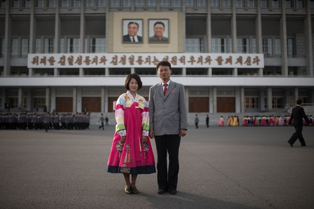In a photo taken on April 9, 2017 students Jo Jong-Im (19, L) and Jo Kwang-Hyok (31, R) pose for a portrait following a mass dance event in central Pyongyang. (Photo by Ed Jones/AFP Photo)