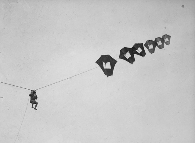 Lieutenant Kirk Booth of the U.S. Signal Corps being lifted skyward by the giant Perkins man-carrying kite at Camp Devens, Ayer, Massachusetts. While the United States never used these kites during the war, the German and French armies put some to use on the front lines. (Photo by U.S. National Archives via The Atlantic)