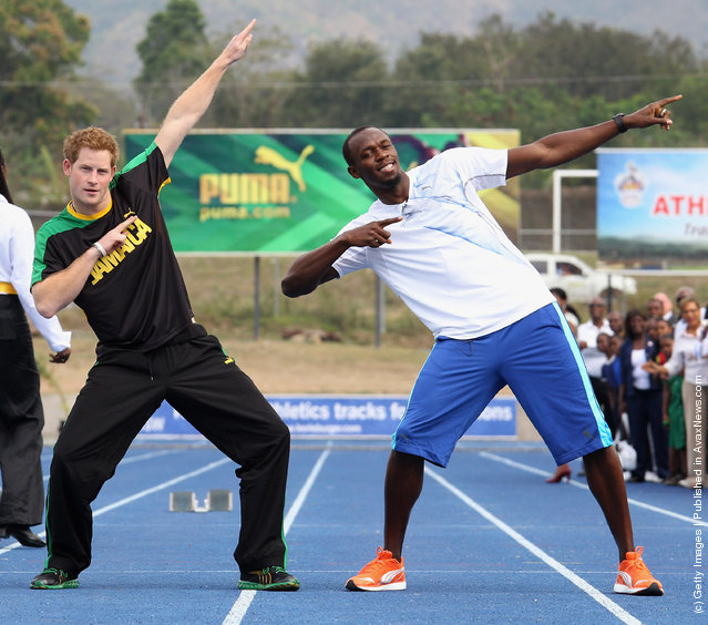 Prince Harry poses with Usain Bolt at the Usain Bolt Track at the University of the West Indies on March 6, 2012 in Kingston