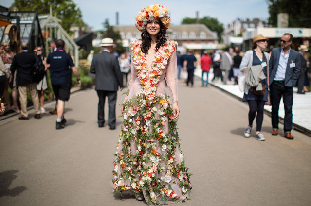 A woman wearing an outfit decorated with flowers poses at the Chelsea Flower Show on May 22, 2017 in London, England. The prestigious Chelsea Flower Show, held annually since 1913 in the Royal Hospital Chelsea grounds, is open to the public from the 23rd to the 27th of May, 2017. (Photo by Jack Taylor/Getty Images)