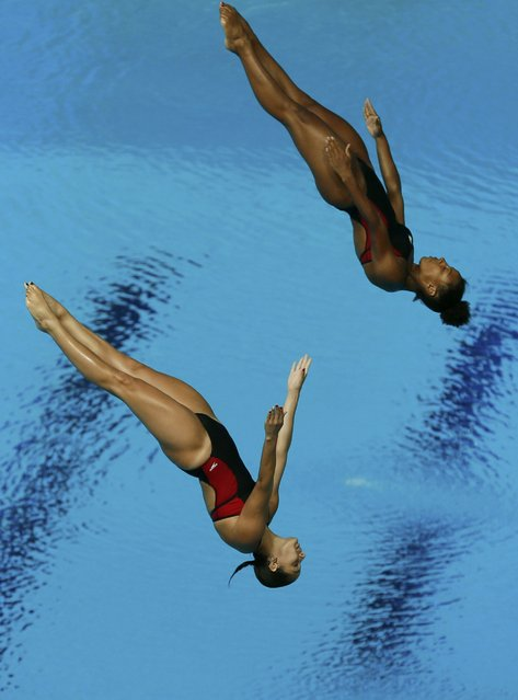 Canada's Jennifer Abel and Pamela Ware compete in the women's synchronized 3m springboard diving heats at the Aquatics World Championships in Kazan, Russia, July 25, 2015. (Photo by Stefan Wermuth/Reuters)