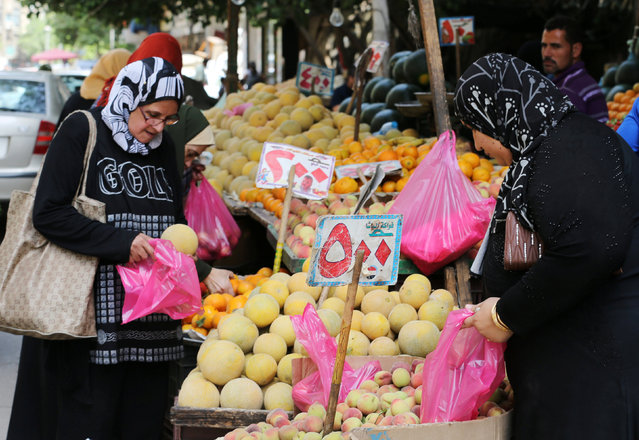 Egyptian women shop at a vegetable market in Cairo, Egypt May 10, 2016. (Photo by Mohamed Abd El Ghany/Reuters)