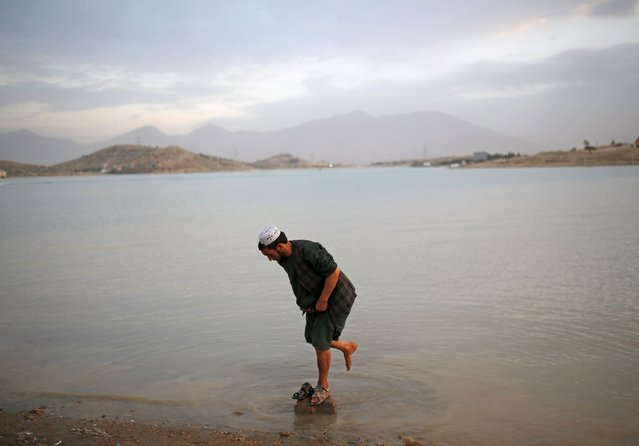 An Afghan man washes his feet in Qargha lake in Kabul, Afghanistan July 21, 2015. (Photo by Ahmad Masood/Reuters)