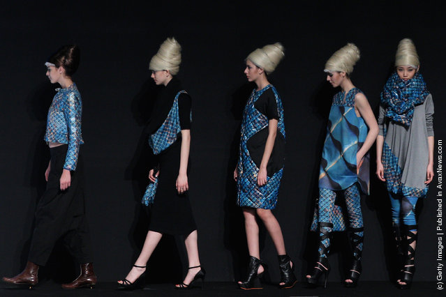 Models showcase designs on the catwalk during OudiFu Collection A/W 2012-2013 of China Fashion Week at Beijing Hotel