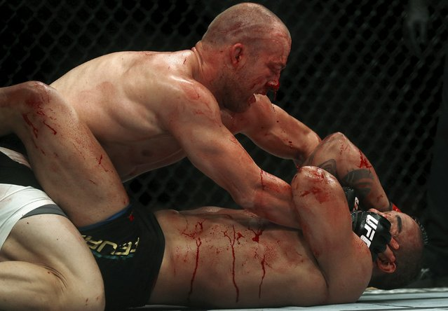 Rafael Cavalcante (R) of Brazil fights with Patrick Cummins of U.S during their Ultimate Fighting Championship (UFC) match, a professional mixed martial arts (MMA) competition in Rio de Janeiro, Brazil August 1, 2015. (Photo by Ricardo Moraes/Reuters)