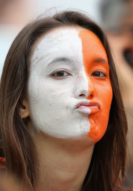 A Netherlands fan enjoys the atmosphere prior to the 2014 FIFA World Cup Brazil Semi Final match between the Netherlands and Argentina at Arena de Sao Paulo on July 9, 2014 in Sao Paulo, Brazil. (Photo by Dean Mouhtaropoulos/Getty Images)