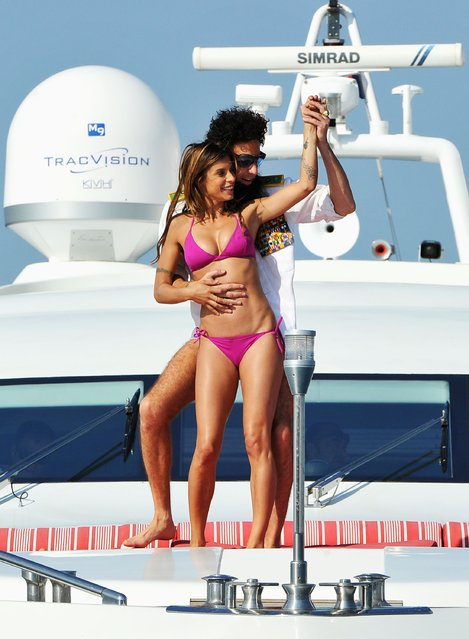 Admiral General Aladeen and supermodel Elisabetta Canalis spotted on a luxury yacht at Hotel Du Cap during 65th Annual Cannes Film Festival