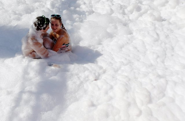 A couple play in foam during the Sziget music festival on an island in the Danube River in  Budapest, Hungary August 12, 2015. (Photo by Laszlo Balogh/Reuters)