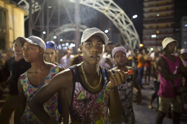 Felix Yandez, 16, (C), reacts to the camera during a concert in honor of Cuba's former President Fidel Castro for his birthday at the Anti-Imperialist Stage in Havana August 12, 2015. Castro will celebrate his 89th birthday on August 13, 2015. (Photo by Alexandre Meneghini/Reuters)