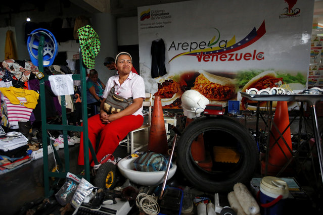 A woman sells second-hand goods in a market in Caracas, Venezuela, June 26, 2016. (Photo by Mariana Bazo/Reuters)