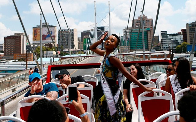 Miss Universe, Zozibini Tunzi poses for a photograph on a open-topped bus as she tours through the streets as part of her triumphant homecoming tour in Johannesburg on February 13, 2020. (Photo by Phill Magakoe/AFP Photo)