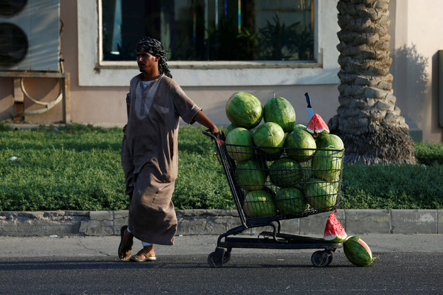 A vendor sells watermelons in Dammam, Saudi Arabia August 10, 2017. (Photo by Faisal Al Nasser/Reuters)