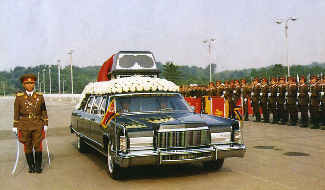 In this July 19,1994, file photo released by the Korean Central News Agency and distributed by the Korea News Service, the vehicle carrying the body of North Korean leader Kim Il Sung passes by the honor guard during his funeral in Pyongyang, North Korea. For nearly 70 years, the three generations of the Kim family have run North Korea with an absolute rule that tolerates no dissent. The ruling family has devoted much of the country's scarce resources to its military but has constantly feared Washington is intent on destroying the authoritarian government. (Photo by Korean Central News Agency/Korea News Service via AP Photo)