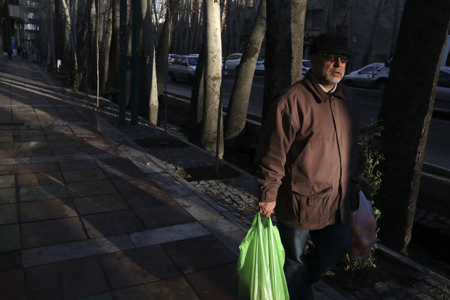A man carries his shopping in northern Tehran, Iran, Thursday, January 9, 2020. (Photo by Vahid Salemi/AP Photo)
