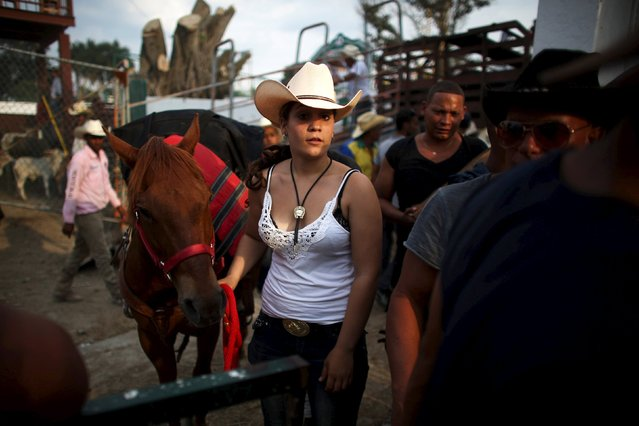 Malena Olivera, 14, takes her horse after performing at the International Livestock Fair Show in Havana, March 22, 2015. (Photo by Alexandre Meneghini/Reuters)