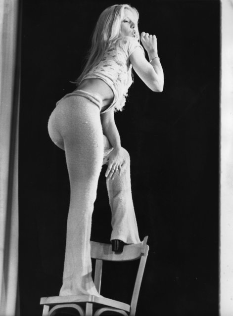 """French pop singer Sylvie Vartan adopts a studied pose, standing on a chair. She is returning to the Paris Olympia accompanied by her """"Boys"""". Sylvie's act at Olympia is choreographed by Ramene from Los Angeles. 8th September 1972. (Photo by Keystone)"""