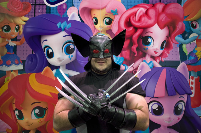 Nick Edwards, who is dressed as the character Wolverine, poses for a photograph in front of a display for My Little Pony during the third day of Comic-Con 2016, in San Diego, California, USA, 23 July 2016. (Photo by David Maung/EPA)