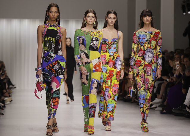 Models wear creations as part of the Versace women's Spring/Summer 2018 fashion collection, presented in Milan, Italy, Friday, September 22, 2017. (Photo by Luca Bruno/AP Photo)
