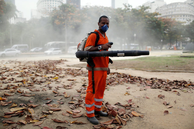 """Andre Barros, a 44-year-old street cleaner, poses for a portrait in Rio de Janeiro, Brazil, July 20, 2016. When asked what he felt about Rio de Janeiro hosting the Olympics, Andre said, """"I can't afford tickets to the Olympics. I need to work"""". He also said, """"People will benefit from the improvement of public transport"""". (Photo by Pilar Olivares/Reuters)"""