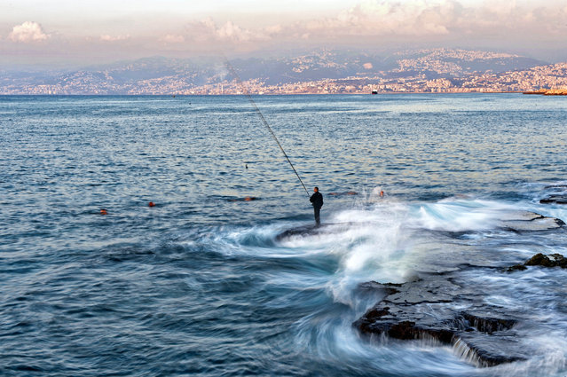 A photograph taken with a low shutter speed shows a fishing man during a sunny day at the Corniche al-Manara in Beirut, Lebanon,​ 16 September 2019. (Photo by Wael Hamzeh/EPA/EFE)