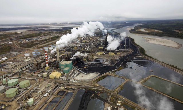 The Suncor tar sands processing plant near the Athabasca River at their mining operations near Fort McMurray, Alberta, September 17, 2014. (Photo by Todd Korol/Reuters)