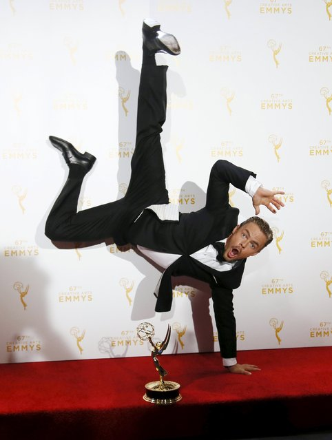 "Derek Hough poses with his outstanding choreography award for ""Dancing with the Stars"" that he won along with Julianne Hough and Tessandra Chavez, backstage at the 2015 Creative Arts Emmy Awards in Los Angeles, California, September 12, 2015. (Photo by Danny Moloshok/Reuters)"